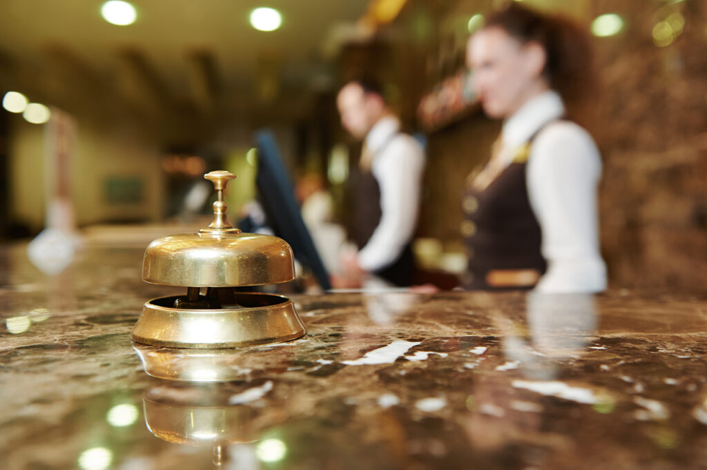 Modern,Luxury,Hotel,Reception,Counter,Desk,With,Bell